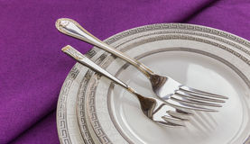 Plates and forks on the table Royalty Free Stock Image