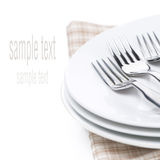 Plates and forks - utensils for serving, isolated Royalty Free Stock Images