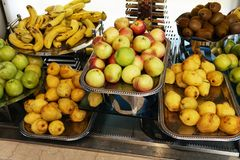 Plates with fresh fruit in the kitchen citrus apples healthy food royalty free stock photos