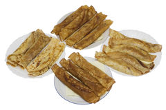 Plates with fried pancakes stock images