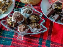 Plates of fudge and truffles. Sweet treats for christmas, plates of fudge, truffles, cookies, all home made Royalty Free Stock Photography