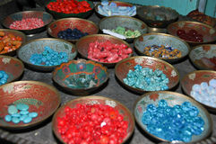 Plates Full Of Stones. Bowls filled with colorful stones which use for and luck jewelery Stock Photo