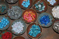 Plates Full Of Stones. Bowls filled with colorful stones which use for and luck jewelery Stock Image