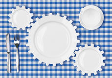 Plates gears work concept. Dinner dishes over tablecloth. Plates gears work concept. Dinner dishes over blue tablecloth Royalty Free Stock Images