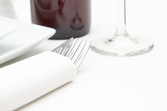 Plates, glass  and red wine on white cloth Royalty Free Stock Images