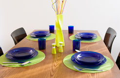 Plates, glasses and cutlery on the table Stock Images