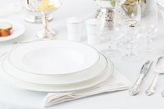 Plates, glasses and silverware Royalty Free Stock Photo