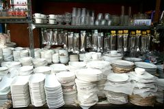 Plates, glassware, utensils and other kitchenware sold at a store in Dapitan Arcade in Manila, Philippines. Stock Photo