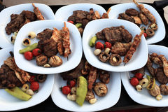 Plates with grilled meat and vegetables Stock Photography