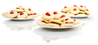 Plates of homemade cookies. Three plates of homemade cookies on white Royalty Free Stock Photo