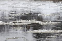 Plates of ice floating on a river Stock Photos