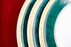 Plates isolated on red Stock Photography