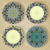 Plates with kaleidoscope pattern set Royalty Free Stock Images