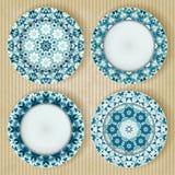 Plates with kaleidoscope pattern set Stock Image