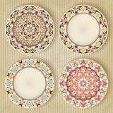 Plates with kaleidoscope pattern set Stock Photo