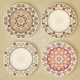 Plates with kaleidoscope pattern set Stock Photo