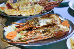 Plates with lobster on table Royalty Free Stock Photo