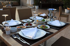 Plates with meze on dining table Royalty Free Stock Images
