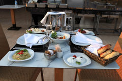 Plates with meze on table Stock Images