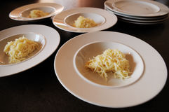 Plates with noodles. Plates with noodles waiting for the soup and serving stock photo