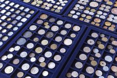 Plates with old coins collection Royalty Free Stock Photo