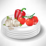 Plates with pepper, garlic and tomatoes Stock Images