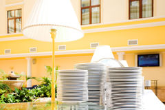 Plates piles and lamp Stock Photo