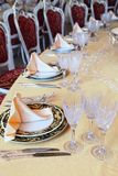 Plates with placemat at the dinner table. Three goblets, two knives and two plates with placemat at the dinner table in restaurant Stock Photography