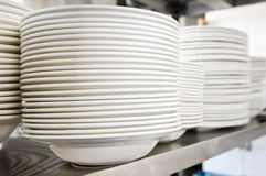 Plates in professional kitchen. Stacked plates in professional kitchen Stock Image