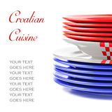 Plates in red, white and blue, concept of Croatian cuisine Stock Photos