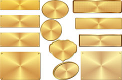 Plates. Set of isolated golden plates Royalty Free Stock Image
