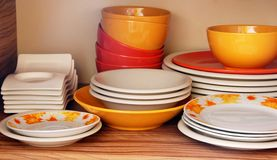 Plates on shelf Royalty Free Stock Images