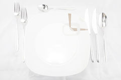 Plates with a silver fork Stock Images