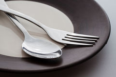 Plates with a silver fork and spoon  Royalty Free Stock Photos
