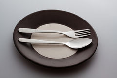 Plates with a silver fork and spoon  Stock Photo