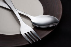 Plates with a silver fork and spoon isolated Royalty Free Stock Image