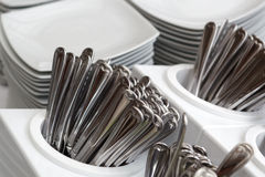 Plates and silverware. A set of plates and silverware on a serving line Stock Photo