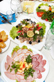 Plates with smoked fish and pork Stock Images