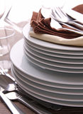 Plates stack an cutlery Stock Photo