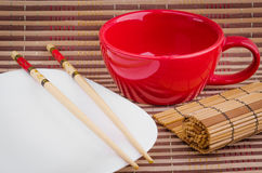 Plates for sushi and bamboo sticks. Lie on a napkin Stock Photo