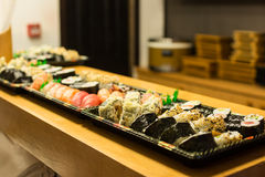 Plates with sushi rolls Stock Photo