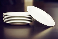 Plates on a table Royalty Free Stock Images