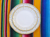 Plates And Tablecloth. The close view of plates on a traditional Mexican tablecloth Royalty Free Stock Photo