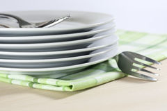 Plates on tablecloth in kitchen Stock Photos