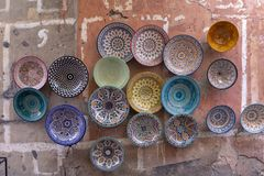 Plates, tajines and pots made of clay on the souk in Chefchaouen royalty free stock images