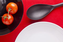 Plates and Tomatoes Stock Image
