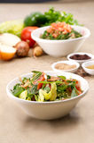 Plates of traditional Arabic salad fattouch and tabbouleh on a rustic background Royalty Free Stock Image