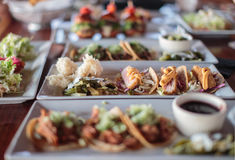 Plates of various appetizers on the table. Variety of Appetizers on white plates Stock Photo
