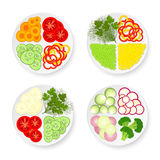 Plates with vegetables Stock Photography