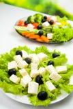 Plates with vegetarian salad Stock Photos